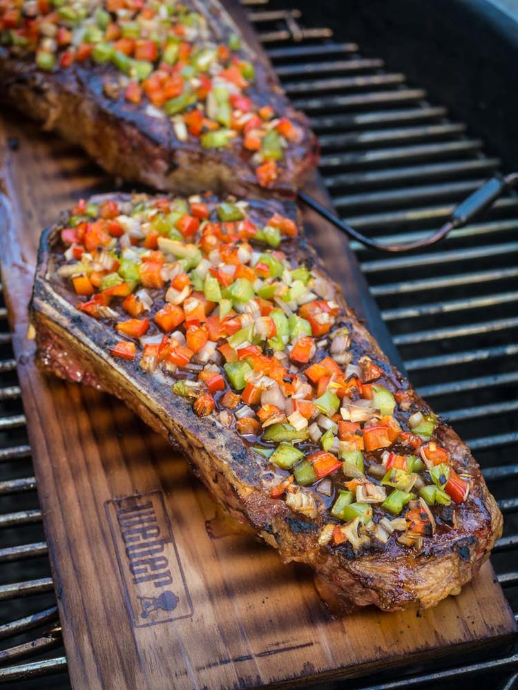 Cedar Plank Grilled New York Strip Steaks With Peppers And