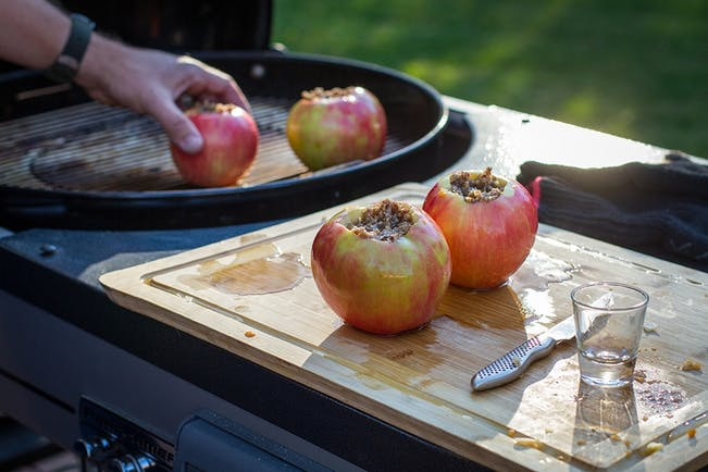 58459365A389F  Placing  Stuffed  Apples On  Grill  Feature