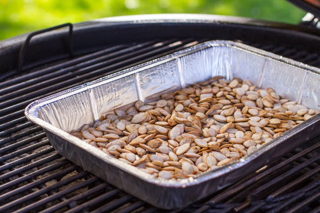 59F72Ed7Aa06A  Grilled And  Smoked  Pumpkin  Seeds On A  Weber  Grill Copy