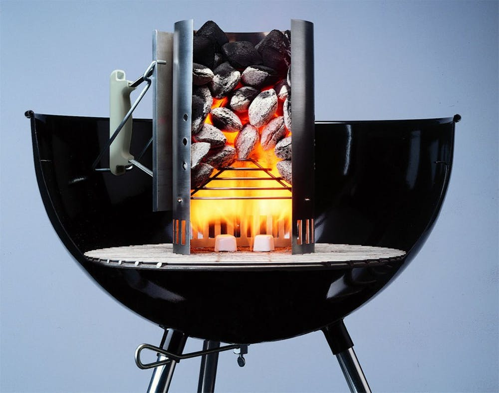 Cut-away view of charcoal chimney starter on grill - Weber Burning Questions